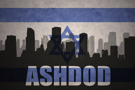 ashdod: abstract silhouette of the city with text Ashdod at the vintage israel flag background Stock Photo