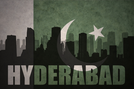 hyderabad: abstract silhouette of the city with text Hyderabad at the vintage pakistan flag background