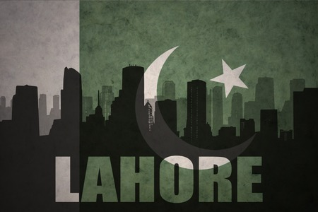 middle east conflict: abstract silhouette of the city with text Lahore at the vintage pakistan flag background Stock Photo