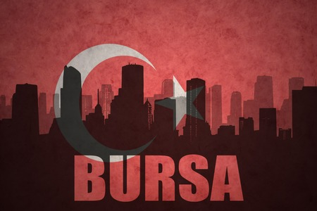 middle east conflict: abstract silhouette of the city with text Bursa at the vintage turkish flag background Stock Photo