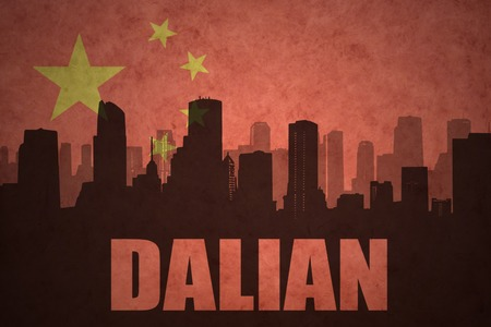 clash: abstract silhouette of the city with text Dalian at the vintage chinese flag background