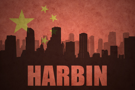 china town: abstract silhouette of the city with text Harbin at the vintage chinese flag background