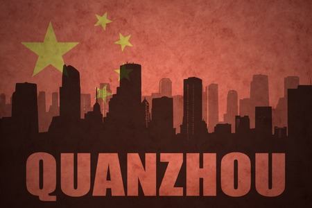 clash: abstract silhouette of the city with text Quanzhou at the vintage chinese flag background