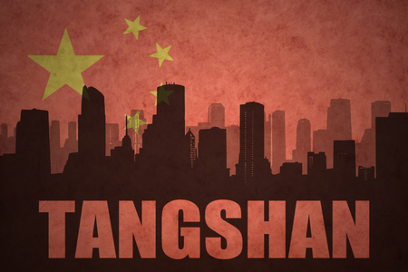 clash: abstract silhouette of the city with text Tangshan at the vintage chinese flag background