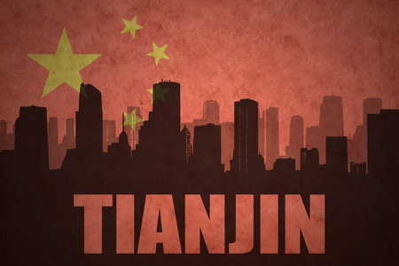 clash: abstract silhouette of the city with text Tianjin at the vintage chinese flag background Stock Photo