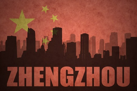 clash: abstract silhouette of the city with text Zhengzhou at the vintage chinese flag background