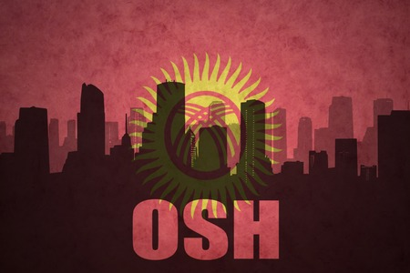 osh: abstract silhouette of the city with text Osh at the vintage kyrgyzstan flag background