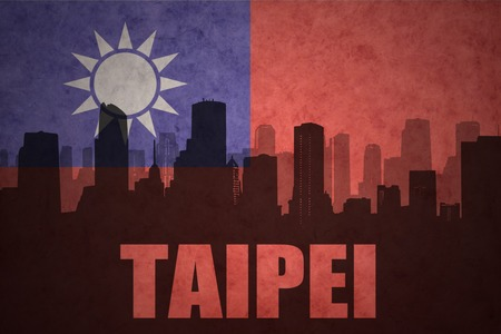 clash: abstract silhouette of the city with text Taipei at the vintage taiwan flag background