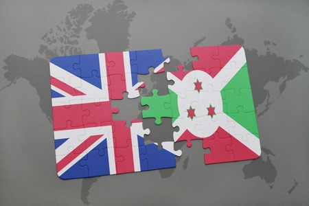 bujumbura: puzzle with the national flag of great britain and burundi on a world map background. 3D illustration Stock Photo