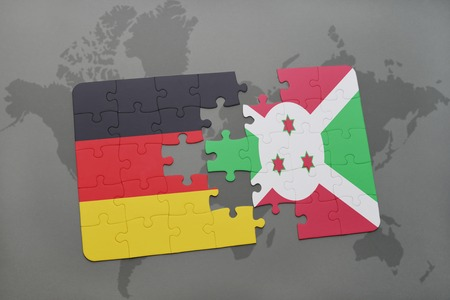bujumbura: puzzle with the national flag of germany and burundi on a world map background. 3D illustration