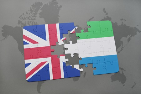puzzle with the national flag of great britain and sierra leoneon a world map background. 3D illustration Stock Illustration - 63985534