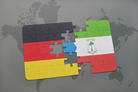 equatorial guinea: puzzle with the national flag of germany and equatorial guinea on a world map background. 3D illustration Stock Photo