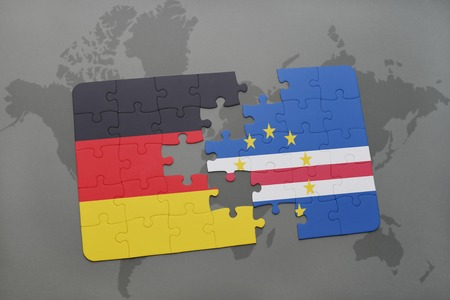 praia: puzzle with the national flag of germany and cape verde on a world map background. 3D illustration Stock Photo
