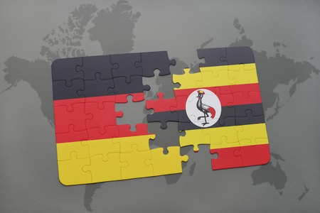 kampala: puzzle with the national flag of germany and uganda on a world map background. 3D illustration Stock Photo