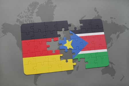 south sudan: puzzle with the national flag of germany and south sudan on a world map background. 3D illustration Stock Photo