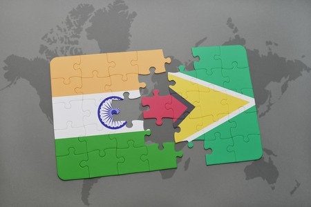guyanese: puzzle with the national flag of india and guyana on a world map background. 3D illustration