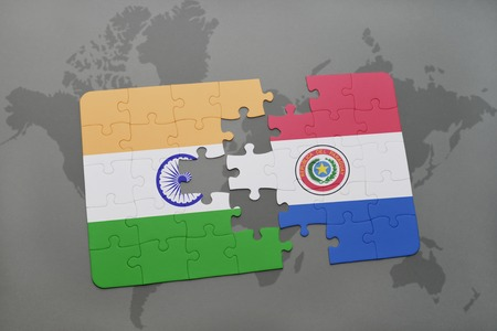 puzzle with the national flag of india and paraguay on a world map background. 3D illustration