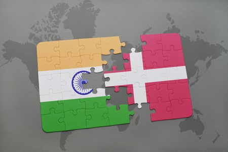 danish flag: puzzle with the national flag of india and denmark on a world map background. 3D illustration Stock Photo
