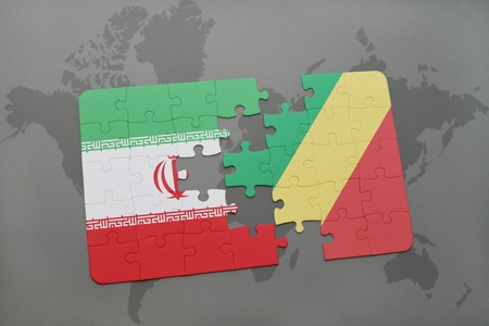 puzzle with the national flag of iran and republic of the congo on a world map background. 3D illustration Stock Photo