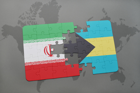 bahamas map: puzzle with the national flag of iran and bahamas on a world map background. 3D illustration