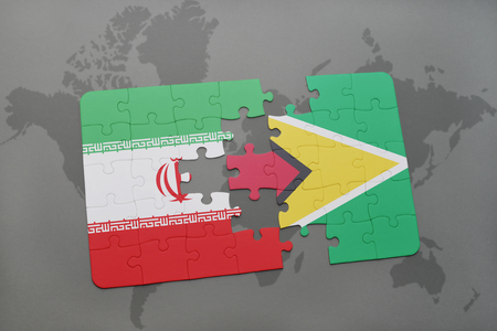 guyanese: puzzle with the national flag of iran and guyana on a world map background. 3D illustration Stock Photo