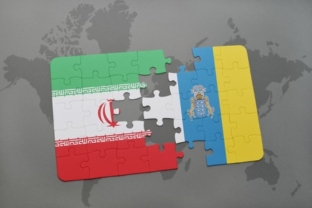 canary: puzzle with the national flag of iran and canary islands on a world map background. 3D illustration