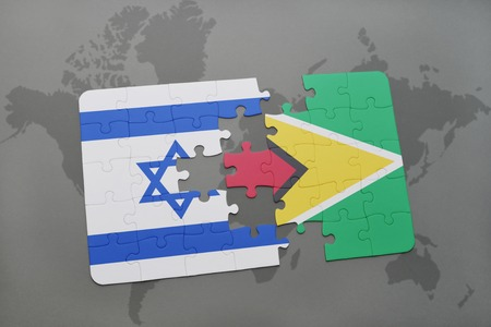 guyanese: puzzle with the national flag of israel and guyana on a world map background. 3D illustration Stock Photo