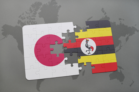 kampala: puzzle with the national flag of japan and uganda on a world map background. 3D illustration