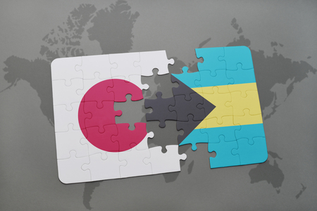 bahamas map: puzzle with the national flag of japan and bahamas on a world map background. 3D illustration Stock Photo
