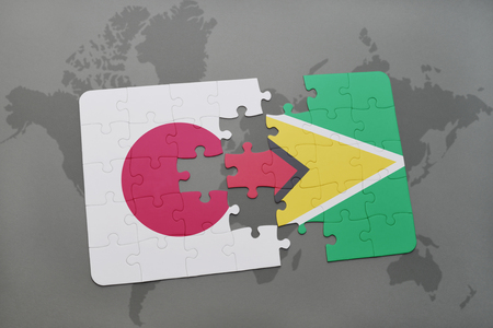 guyanese: puzzle with the national flag of japan and guyana on a world map background. 3D illustration