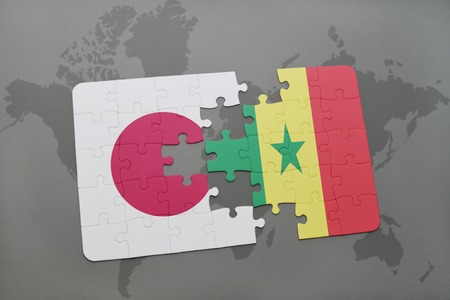 dakar: puzzle with the national flag of japan and senegal on a world map background. 3D illustration