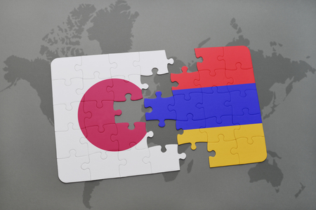 yerevan: puzzle with the national flag of japan and armenia on a world map background. 3D illustration