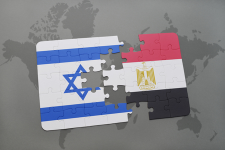 aviv: puzzle with the national flag of israel and egypt on a world map background. 3D illustration Stock Photo