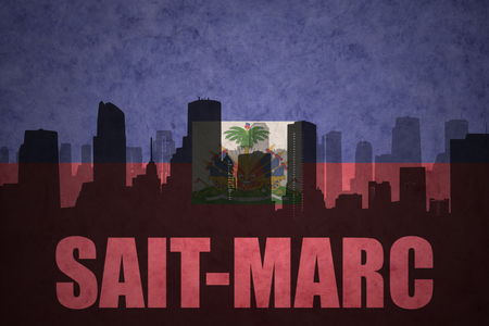 haitian: abstract silhouette of the city with text Saint-Marc at the vintage haitian flag background