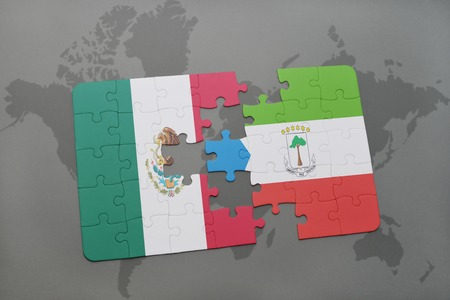 equatorial guinea: puzzle with the national flag of mexico and equatorial guinea on a world map background. 3D illustration