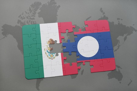 laotian: puzzle with the national flag of mexico and laos on a world map background. 3D illustration Stock Photo