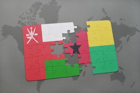 puzzle with the national flag of oman and guinea bissau on a world map background. 3D illustration