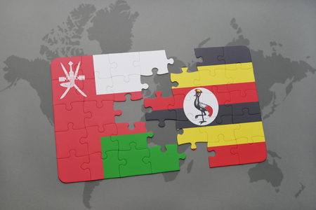 kampala: puzzle with the national flag of oman and ugandaon a world map background. 3D illustration