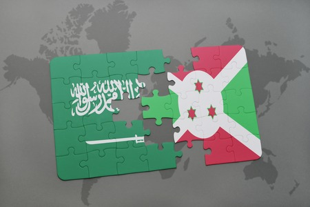 puzzle with the national flag of saudi arabia and burundi on a world map background. 3D illustration Stock Photo