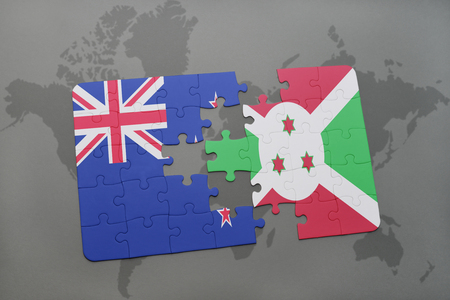 puzzle with the national flag of new zealand and burundi on a world map background. 3D illustration Stock Photo