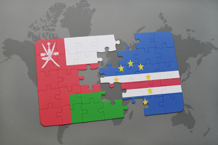 praia: puzzle with the national flag of oman and cape verde on a world map background. 3D illustration Stock Photo