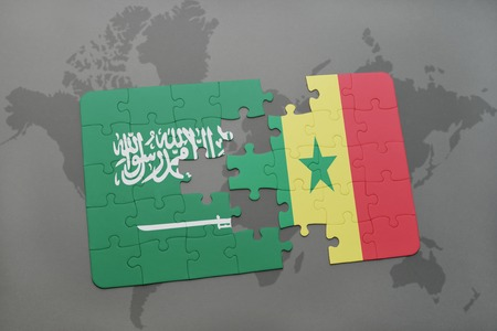 dakar: puzzle with the national flag of saudi arabia and senegal on a world map background. 3D illustration