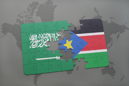 south sudan: puzzle with the national flag of saudi arabia and south sudan on a world map background. 3D illustration Stock Photo