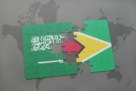 guyanese: puzzle with the national flag of saudi arabia and guyana on a world map background. 3D illustration