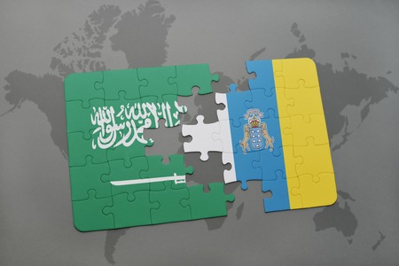 canary: puzzle with the national flag of saudi arabia and canary islands on a world map background. 3D illustration Stock Photo