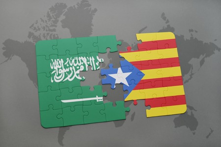 catalonia: puzzle with the national flag of saudi arabia and catalonia on a world map background. 3D illustration Stock Photo