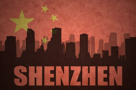 clash: abstract silhouette of the city with text Shenzhen at the vintage chinese flag background