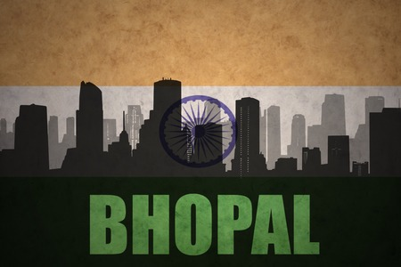bhopal: abstract silhouette of the city with text Bhopal at the vintage indian flag background