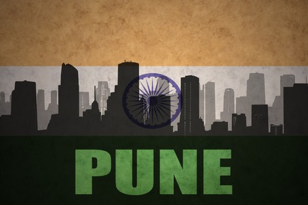 pune: abstract silhouette of the city with text Pune at the vintage indian flag background Stock Photo