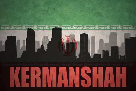 iranian: abstract silhouette of the city with text Kermanshah at the vintage iranian flag background